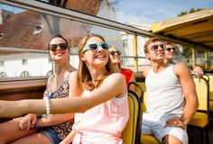 Group of smiling friends traveling by tour bus. Friendship, travel, vacation, summer and people concept - group of smiling friends traveling by tour bus Royalty Free Stock Photo