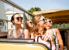 Group of smiling friends traveling by tour bus Royalty Free Stock Photos