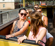 Group of smiling friends traveling by tour bus. Friendship, travel, vacation, summer and people concept - group of smiling friends traveling by tour bus Royalty Free Stock Photos