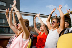 Group of smiling friends traveling by tour bus. Friendship, travel, vacation, summer and people concept - group of smiling friends traveling by tour bus and Royalty Free Stock Photo