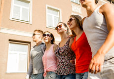 Group of smiling friends walking in city Royalty Free Stock Image