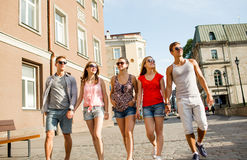 Group of smiling friends walking in city Royalty Free Stock Images