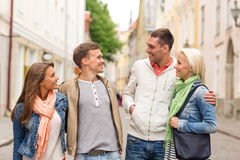 Group of smiling friends walking in the city Stock Photos