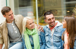 Group of smiling friends walking in the city Royalty Free Stock Photo