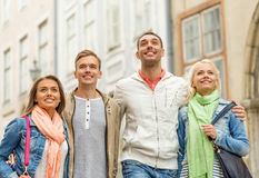 Group of smiling friends walking in the city Stock Photography