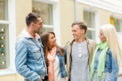 Group of smiling friends walking in the city Stock Photo