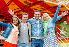Group of smiling friends waving hands Royalty Free Stock Photo
