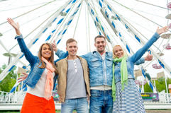 Group of smiling friends waving hands Stock Photos