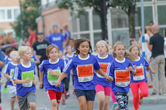 Group of smiling girls and boys running Royalty Free Stock Photo