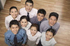 Group of smiling and happy coworkers looking up at camera, portrait, overhead shot Stock Image