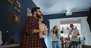 Group of smiling happy multiethnic friends dancing together at fun birthday party celebrating vacation slow motion. stock footage