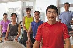 Group of smiling happy people exercising in the gym, portrait Stock Photography