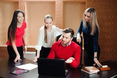 Group of smiling inspired young business people working together stock image
