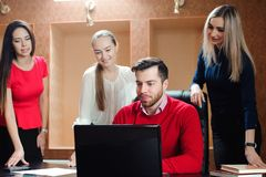 Group of smiling inspired young business people working together stock photography
