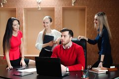 Group of smiling inspired young business people working together royalty free stock image