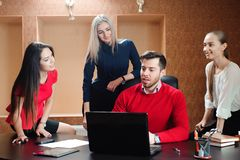 Group of smiling inspired young business people working together royalty free stock images