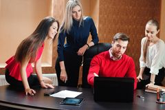 Group of smiling inspired young business people working together in office. stock photo