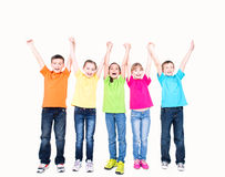 Group of smiling kids with raised hands. Royalty Free Stock Images