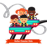 Group of smiling kids riding roller coaster Stock Image