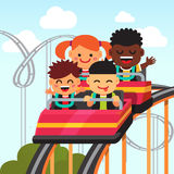 Group of smiling kids riding roller coaster Stock Photography