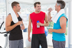 Group of smiling men talking each other. In fitness studio Royalty Free Stock Images