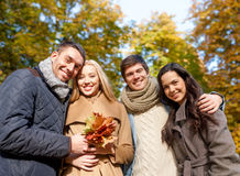 Group of smiling men and women in autumn park Stock Image
