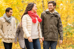 Group of smiling men and women in autumn park Royalty Free Stock Photos