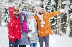 Group of smiling men and women in winter forest Stock Images