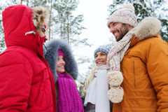 Group of smiling men and women in winter forest Stock Photography