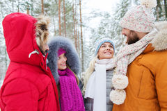 Group of smiling men and women in winter forest Royalty Free Stock Photo