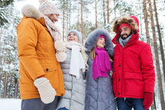 Group of smiling men and women in winter forest Royalty Free Stock Photography