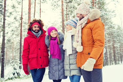 Group of smiling men and women in winter forest Stock Photo