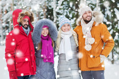 Group of smiling men and women in winter forest Royalty Free Stock Photos