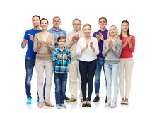 Group of smiling people applauding Stock Photos