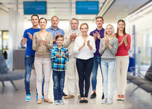 Group of smiling people applauding Royalty Free Stock Photography