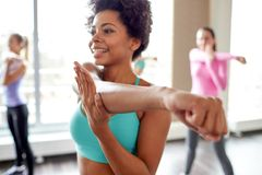 Group of smiling people dancing in gym or studio Royalty Free Stock Photos
