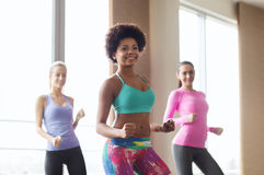 Group of smiling people dancing in gym or studio Stock Photography