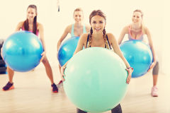 Group of smiling people doing aerobics with balls Stock Photography