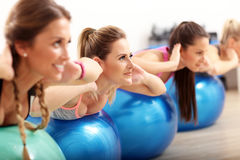 Group of smiling people doing aerobics with balls. Group of happy women doing aerobics with fit balls stock photo