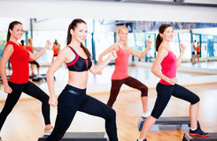 Group of smiling people doing aerobics Stock Photography