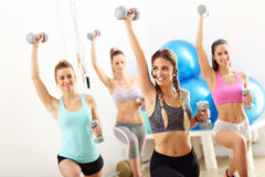 Group of smiling people doing aerobics Royalty Free Stock Photo