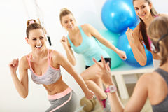 Group of smiling people doing aerobics. Group of happy women doing aerobics stock photos