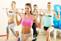 Group of smiling people doing aerobics Stock Image