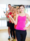 Group of smiling people with dumbbells in the gym Royalty Free Stock Images