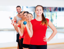 Group of smiling people with dumbbells in the gym Royalty Free Stock Image