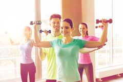 Group of smiling people exercising with dumbbells Stock Image