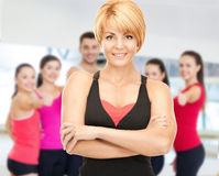 Group of smiling people exercising in the gym Royalty Free Stock Photography