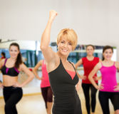Group of smiling people exercising in the gym Royalty Free Stock Image