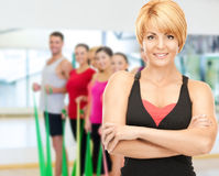 Group of smiling people exercising in the gym Stock Photo