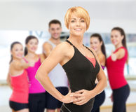 Group of smiling people exercising in the gym Royalty Free Stock Images